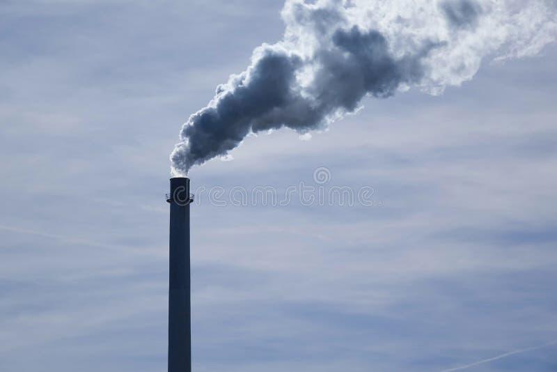 Smoking factory chimney. Bavaria, Germany, Europe stock photo