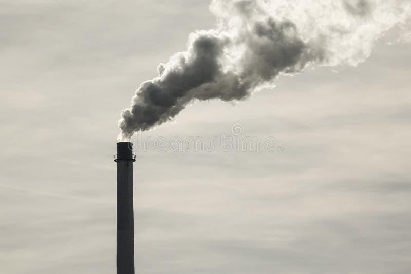 Smoking factory chimney. Bavaria, Germany, Europe royalty free stock image