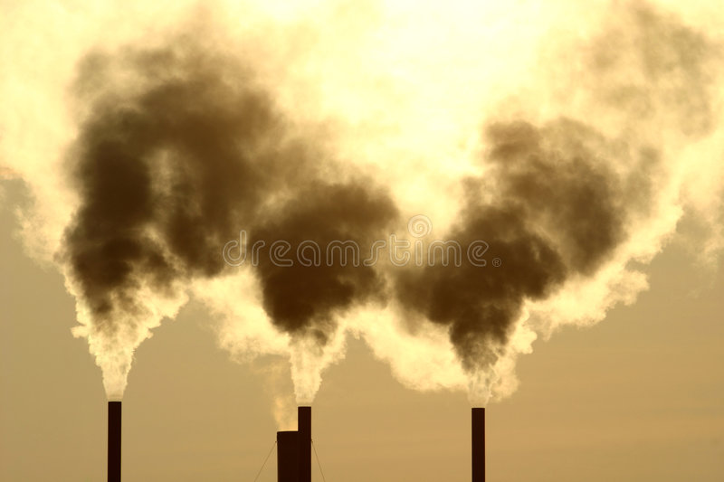 Smoking greenhouse chimneys royalty free stock image