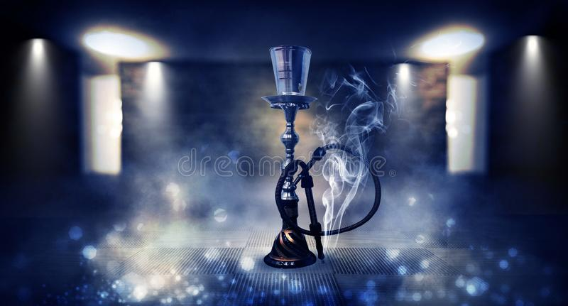 Smoking a hookah against a brick wall, concrete floor, neon light, smoke. Hookah in a dark room, spotlights, smoke, dust, smog royalty free stock photo