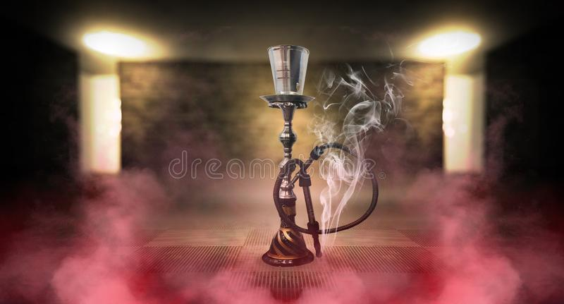 Smoking a hookah against a brick wall, concrete floor, neon light, smoke. Hookah in a dark room, spotlights, smoke, dust, smog stock photo