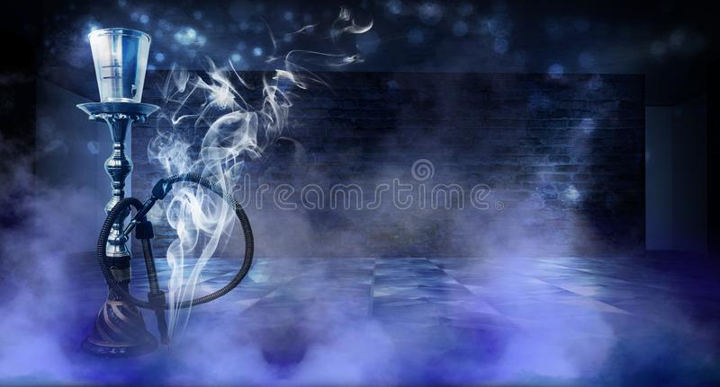 Smoking a hookah against a brick wall, concrete floor, neon light, smoke. Hookah in a dark room, spotlights, smoke, dust, smog royalty free stock photos