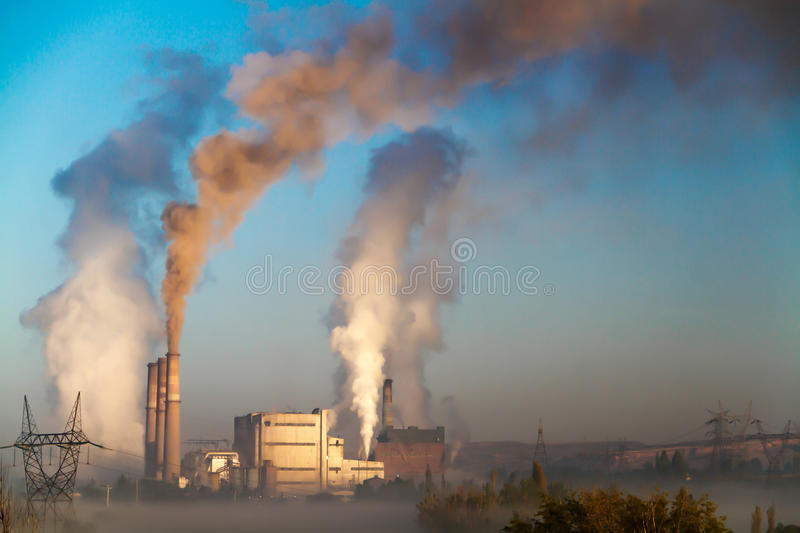 Smoking industrial pipes stock photo