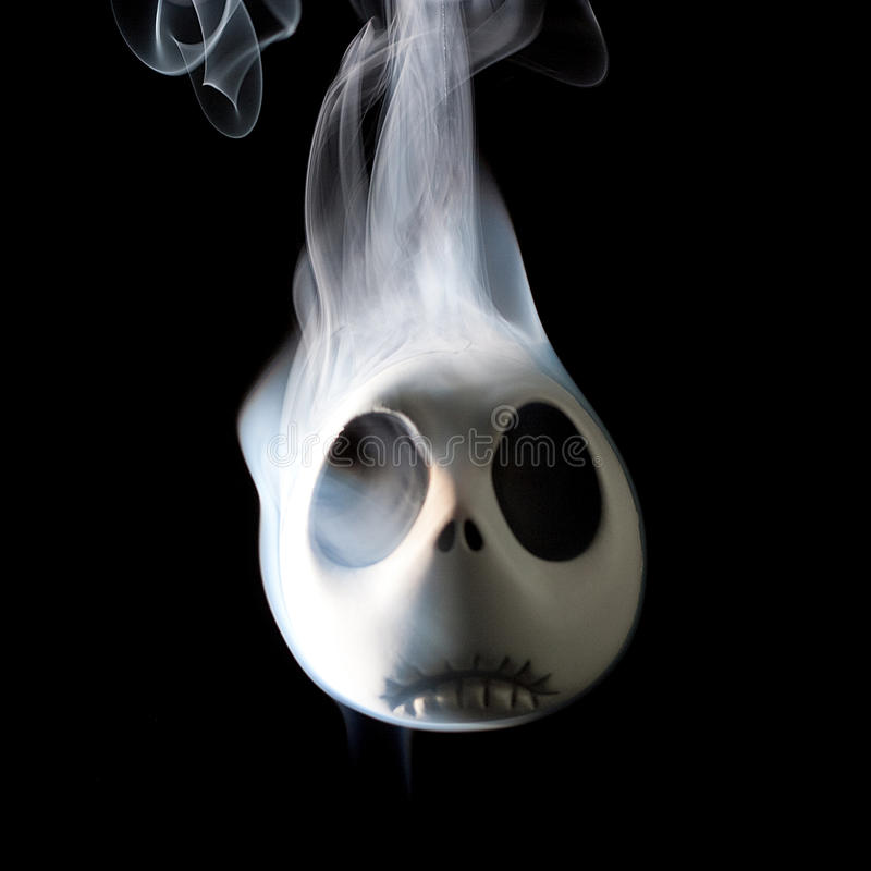 Smoking Jack. Jack Skellington with smoke coming from its head stock image