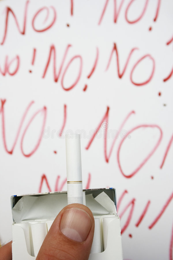 Smoking - Just Say No!. Someone offers a cigarette. Can you refuse? Background there are cries for NO stock images