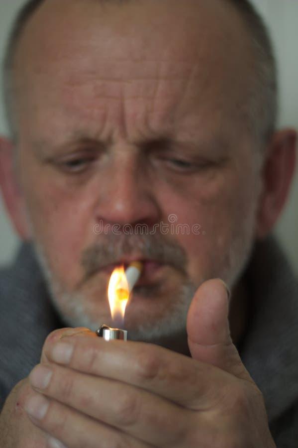 Smoking man with cap royalty free stock images