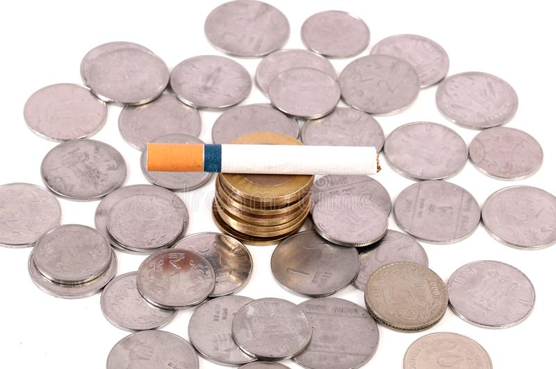 Smoking and money. Concept shot of wasting money by smoking cigarette stock photos