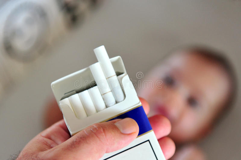 Smoking near children concept photo stock image