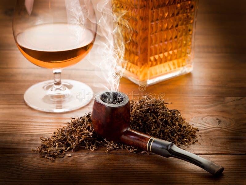 Smoking Pipe And Liquor Stock Photography