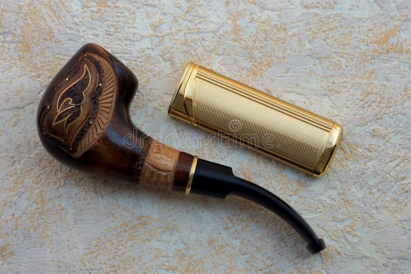 Smoking pipe for tobacco lighter makes it possible to light the pipe stock images