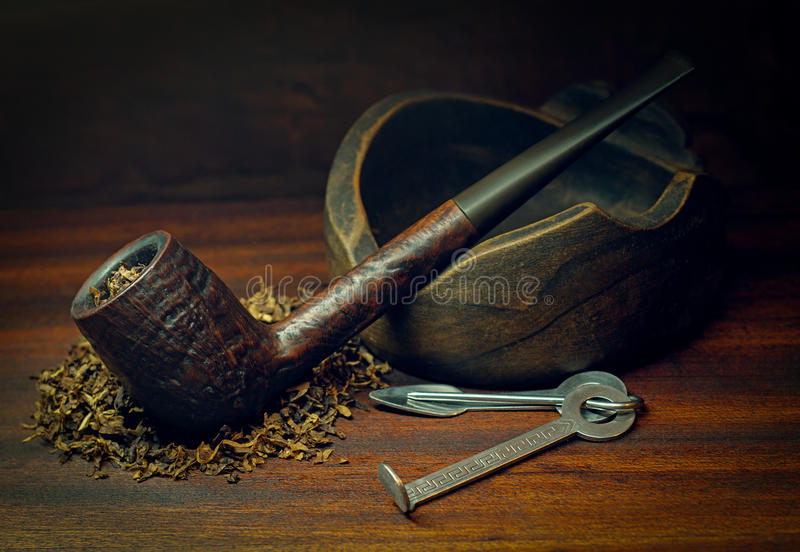 Smoking pipe and tobacco stock image