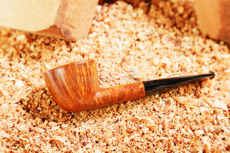 Download Smoking Polished Pipe And Wood Chips Stock Photo - Image: 18705748