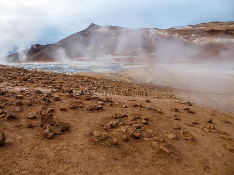 Iceland - Smoking hot pots at the geothermal activie region of Hverir. Smoking pool, filled with sulfur. Thick and dense smoke surrounding the whole area stock photos