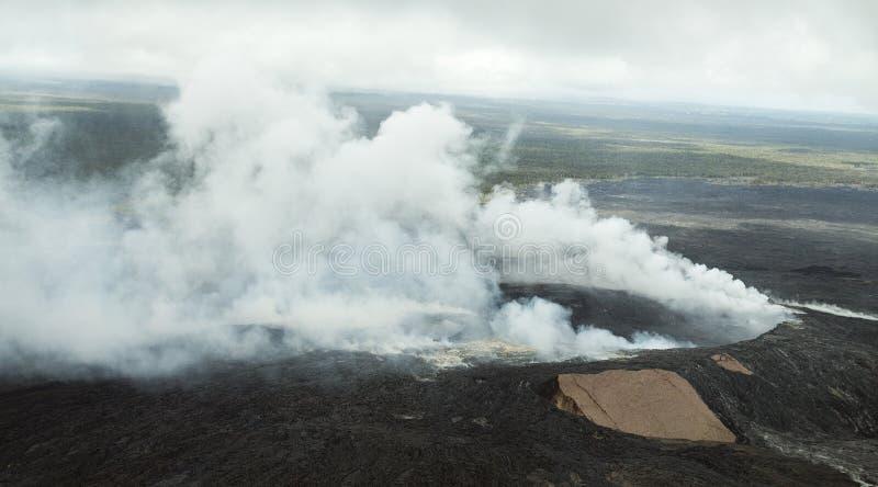 Smoking Pu`u O`o crater Hawaii stock photo