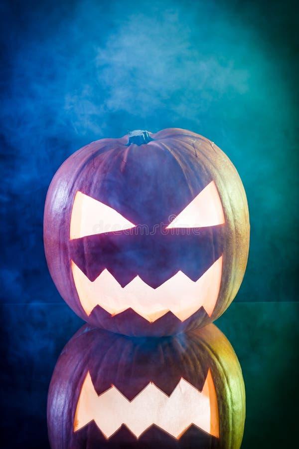 Smoking pumpkin for Halloween stock images