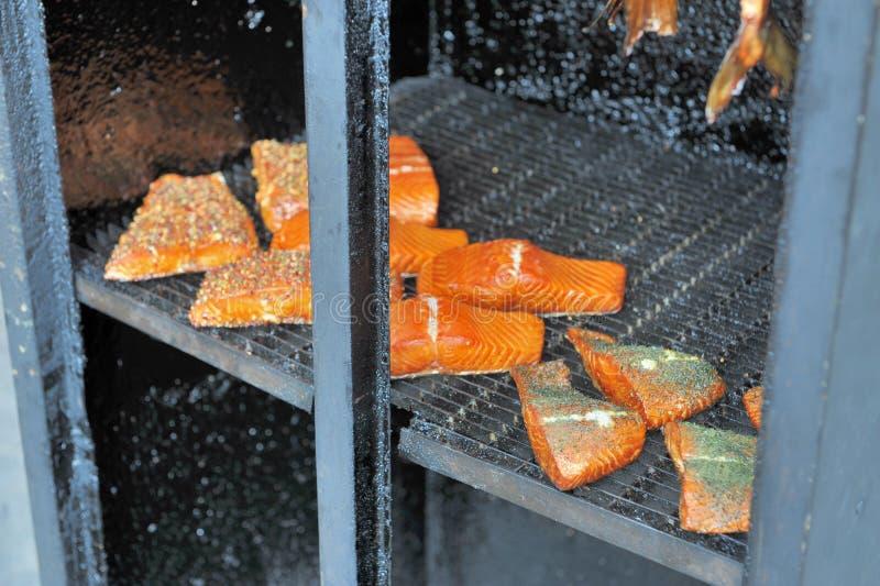 Smoking salmon fillets stock photo