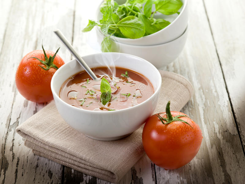 Smoking tomato soup with basil stock images