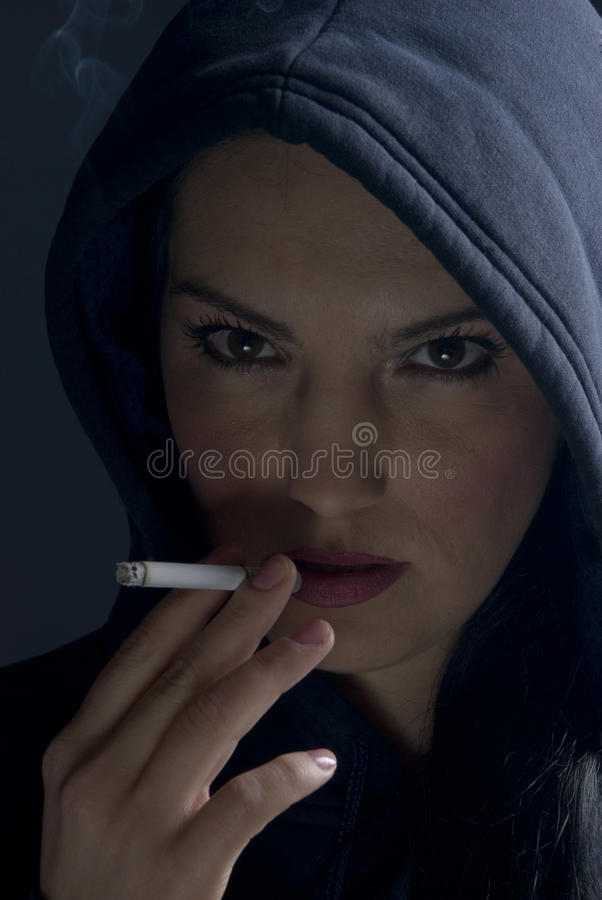 Download Smoking Woman With Hood In Night Stock Photo - Image: 12063638