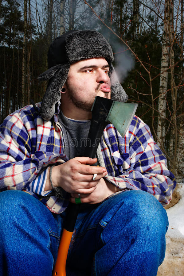Smoking woodcutter with hatchet