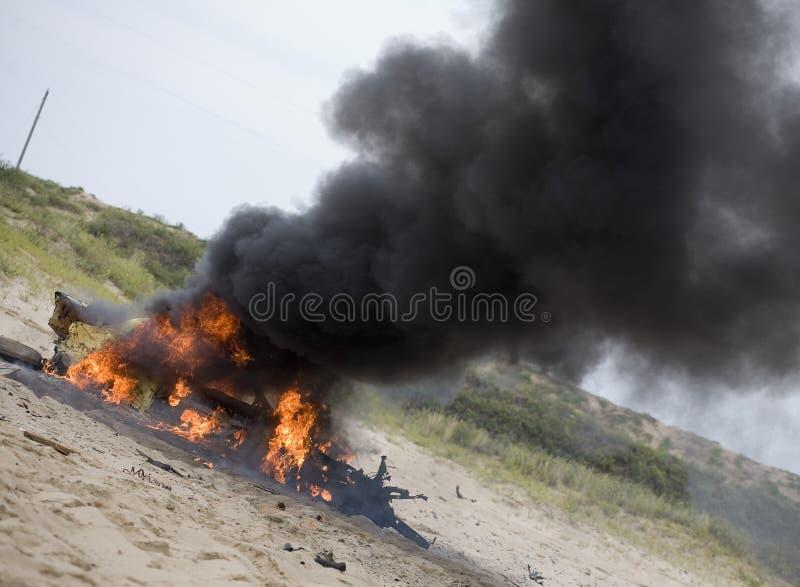 Download Smoking wreck stock image. Image of orange, burning, fire - 27079479