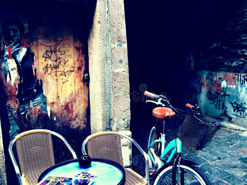 Smoko. Modern urban youth culture. Streetscape with grafiti on the walls, cafe table, chears, cigarettes, bicyle, smoking woman drawn on the wall teen age and stock photography