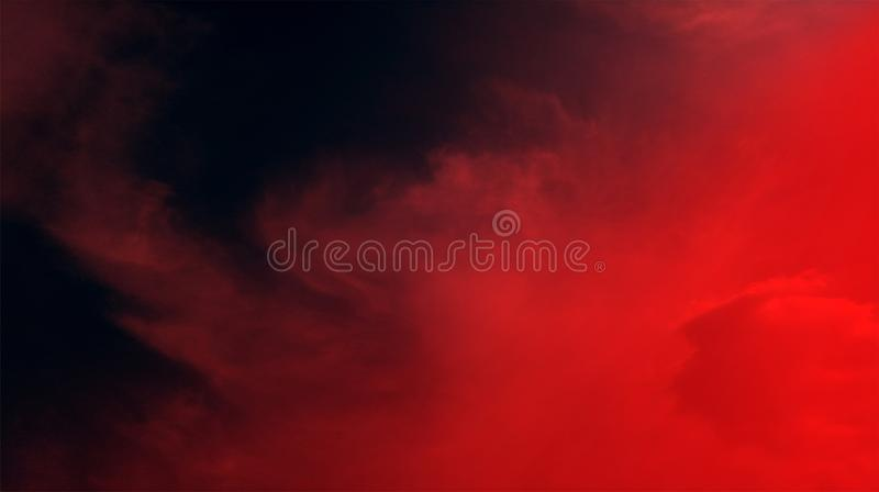 Smoky clouds black red color mixture effects texture background wallpaper. royalty free stock image