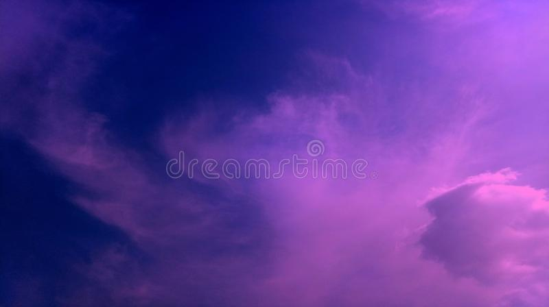 Smoky clouds pink blue color mixture effects texture background wallpaper. stock photo