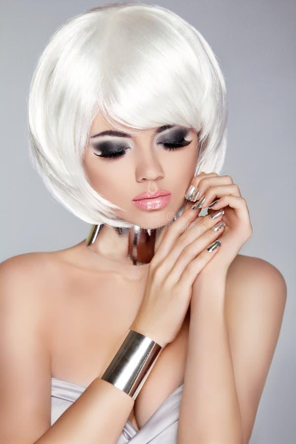 Smoky eye makeup. White Bob Hairstyle. Fashion blong girl model. royalty free stock photos
