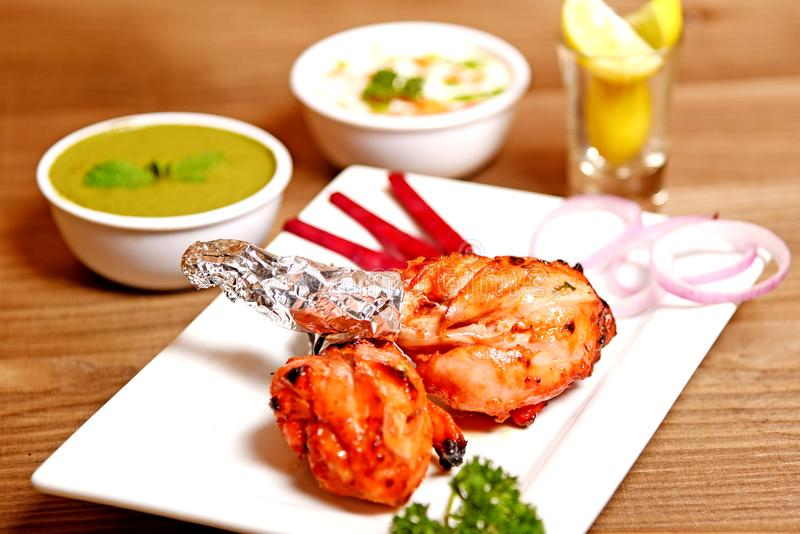 Chicken Tandoori. Smoky and juicy chicken cooked in exotic spices in a tandoor royalty free stock photos