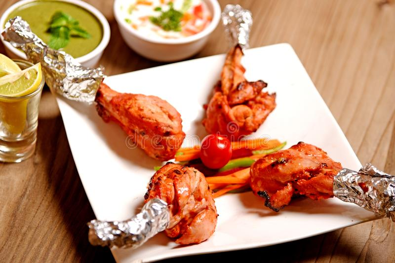 Chicken Tandoori. Smoky and juicy chicken cooked in exotic spices in a tandoor royalty free stock image