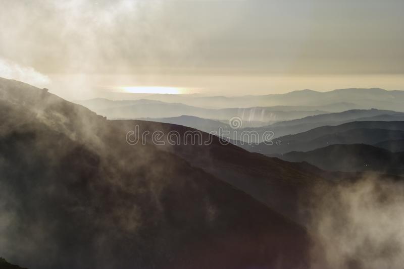 Smoky mountain layers. Seeing the Atlantic Ocean in the foreground. North of Portugal stock photos