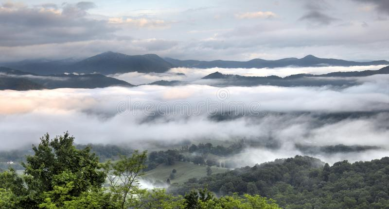 Smoky Mountain valley, Waynesville NC, USA. Clouds and mist in the mountain valley forest. Photographed from Ratcliff Mountain overlooking Waynesville, North stock photography