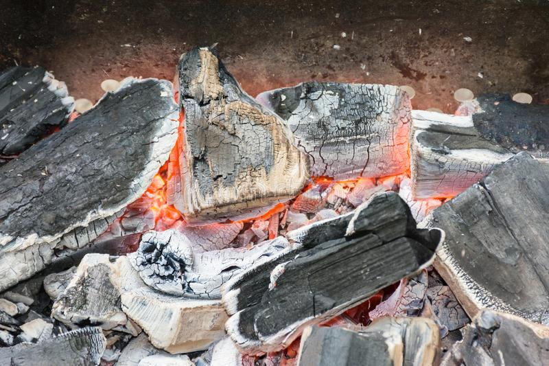 Smoldering embers of fire stock image