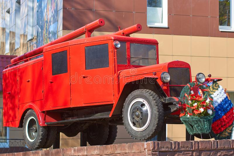 SMOLENSK, RUSSIA - MAY 01, 2018: A monument to an old fire truck near the fire department in Smolensk, Russia. SMOLENSK, RUSSIA - MAY 01, 2018: A monument to an royalty free stock photography