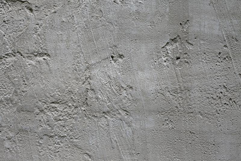 Smooth concrete texture. Beton uneven texture. Photographic pattern. Cement concrete surface. Creme gray rabblework superficies. Concrete superficial area stock image