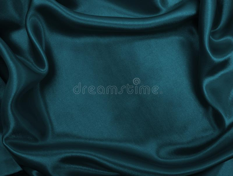 Smooth elegant blue silk or satin luxury cloth texture as abstract background. Luxurious background design. Smooth elegant blue silk or satin luxury cloth stock image