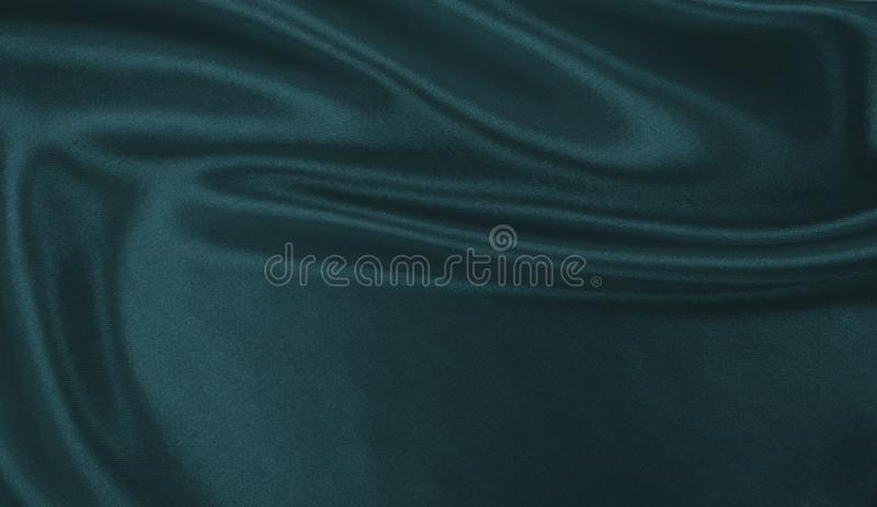 Smooth elegant blue silk or satin luxury cloth texture as abstract background. Luxurious background design. Smooth elegant blue silk or satin luxury cloth royalty free stock photos