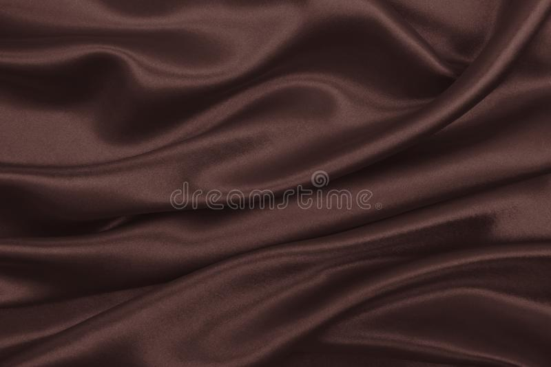 Smooth elegant brown silk or satin texture as abstract background. Luxurious background design. In Sepia toned. Retro style. Smooth elegant brown silk or satin stock photos