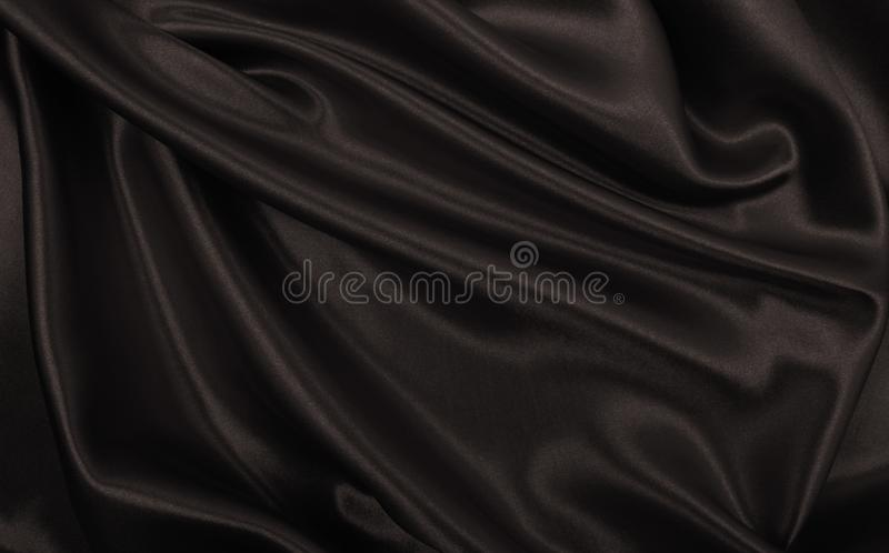 Smooth elegant brown silk or satin texture as abstract background. Luxurious background design. In Sepia toned. Retro style. Smooth elegant brown silk or satin stock image