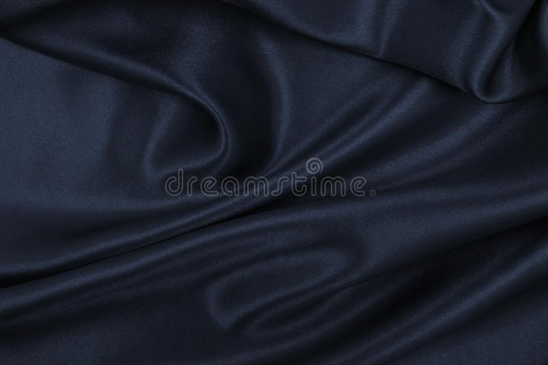 Smooth elegant dark grey silk or satin texture as abstract background. Luxurious background design. Smooth elegant dark grey silk or satin texture can use as stock photography