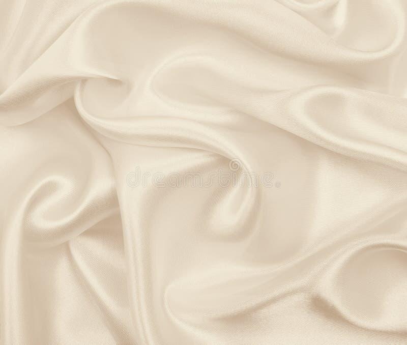 Smooth elegant golden silk or satin luxury cloth texture as wedding background. Luxurious Christmas background or New Year. Smooth elegant golden silk or satin royalty free stock photography