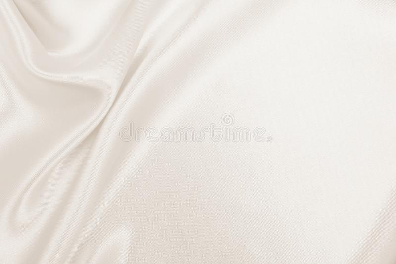 Smooth elegant golden silk or satin luxury cloth texture as wedding background. Luxurious background design. In Sepia toned. Smooth elegant golden silk or satin royalty free stock images