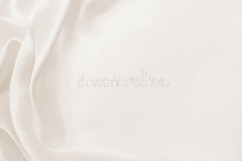 Smooth elegant golden silk or satin luxury cloth texture as wedding background. Luxurious background design. In Sepia toned. Smooth elegant golden silk or satin royalty free stock photography