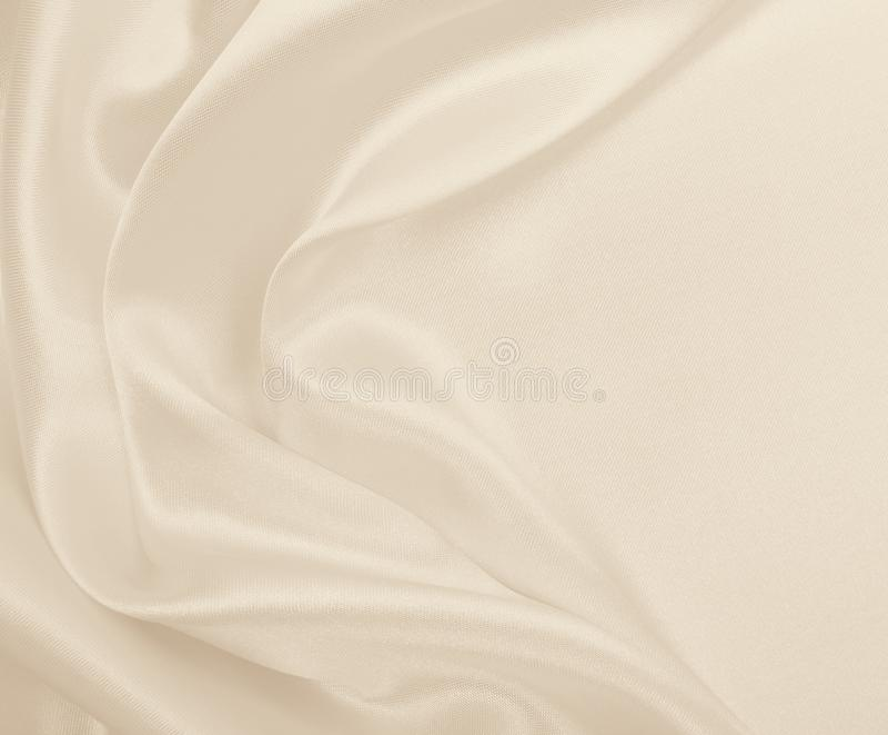 Smooth elegant golden silk or satin luxury cloth texture as wedding background. Luxurious background design. In Sepia toned. Smooth elegant golden silk or satin stock images