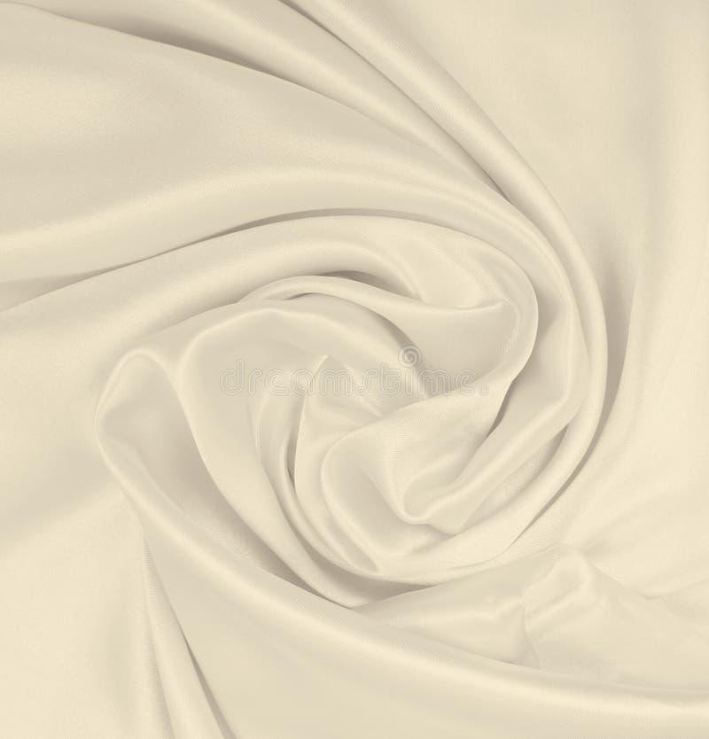 Smooth elegant golden silk or satin luxury cloth texture as wedding background. Luxurious background design. In Sepia toned. Smooth elegant golden silk or satin royalty free stock photos