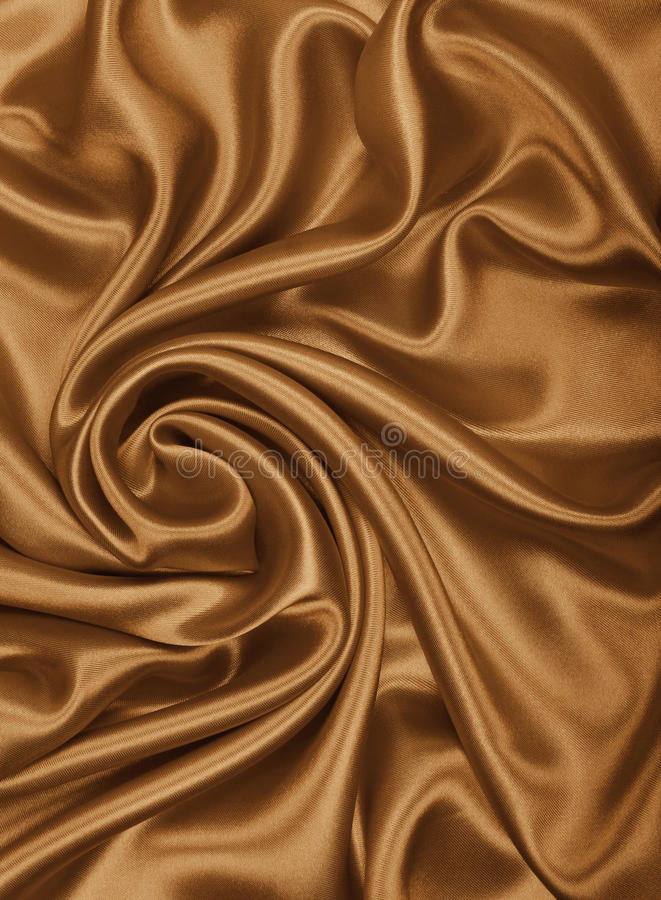 Smooth elegant golden silk or satin texture as abstract background. Luxurious background design wallpaper. In Sepia toned. Retro. Smooth elegant golden silk or royalty free stock photos