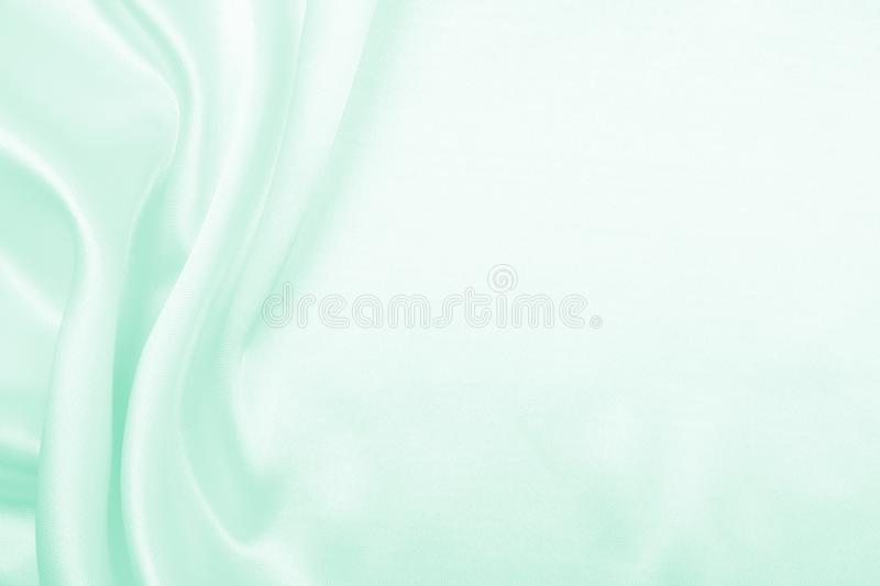 Smooth elegant green silk or satin luxury cloth texture as abstract background. Luxurious background design. Smooth elegant green silk or satin luxury cloth stock images