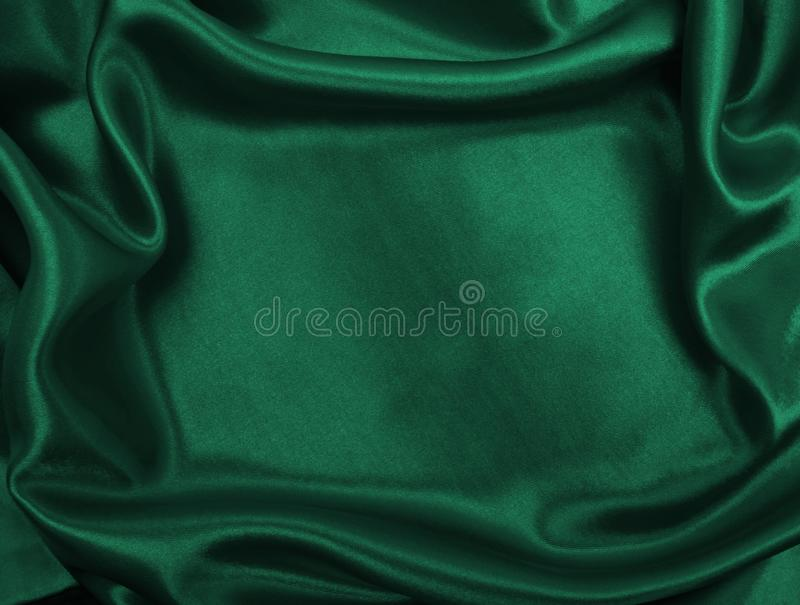 Smooth elegant green silk or satin luxury cloth texture as abstract background. Luxurious background design. Smooth elegant green silk or satin luxury cloth stock image