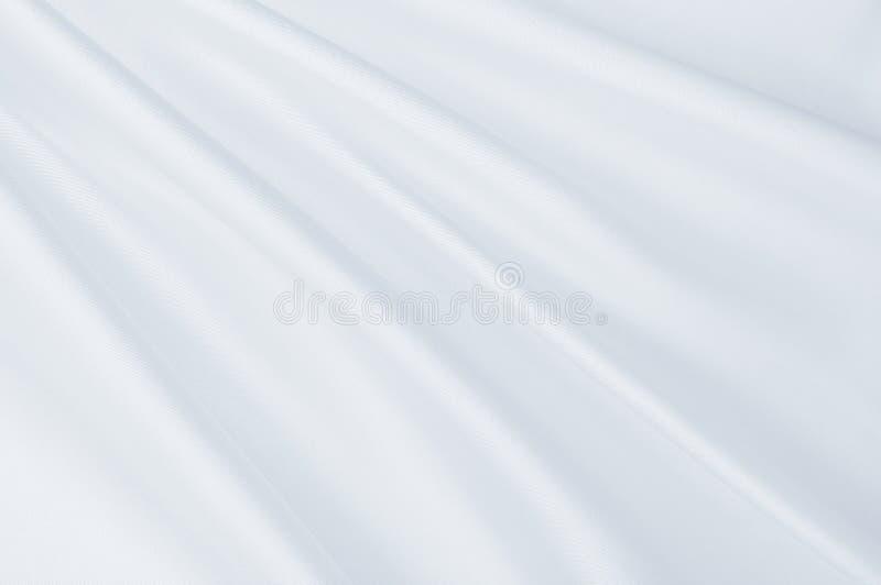Smooth elegant grey silk or satin luxury cloth as wedding background. Luxurious Christmas background or New Year background design. Smooth elegant grey silk or stock images