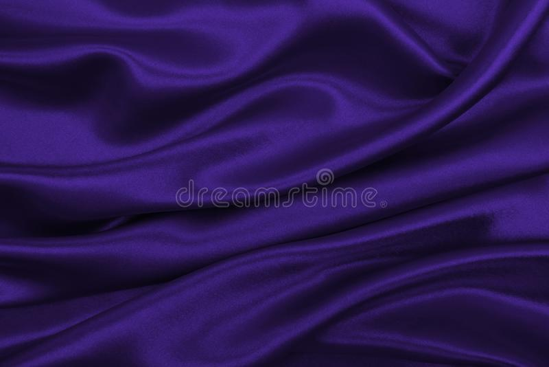 Smooth elegant lilac silk or satin luxury cloth texture as abstract background. Luxurious background design. Smooth elegant lilac silk or satin luxury cloth royalty free stock photos